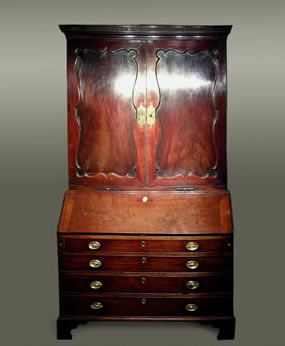 Mahogany bureau cabinet of rich colour, the upper section with a cornice incorporating broken-dentil moulding