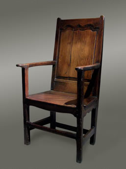Captivating Welsh Oak Armchair With A Fielded Ogee Shaped Panelled Back. ANTIQUE WELSH  OAK ARMCHAIR