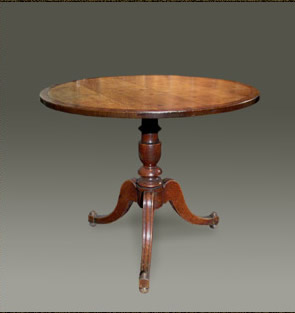 Welsh oak occasional table, the circular tip-top with mahogany cross-banding on a boldly turned pedestal base raised on shaped and moulded legs,