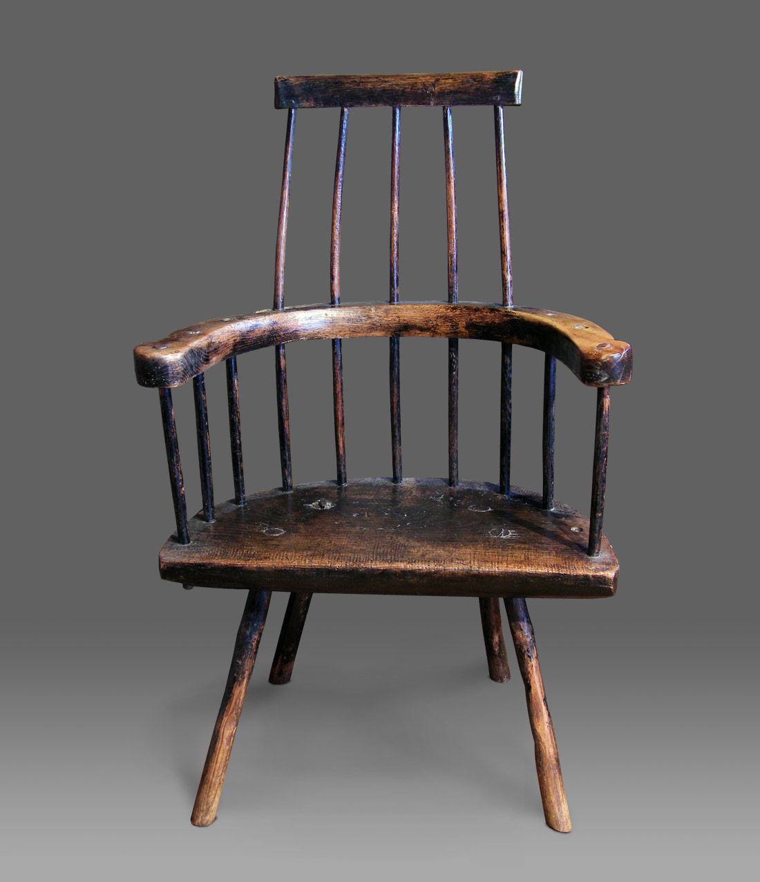 ANTIQUE STICK CHAIR THE COMB BACK sits above swept arms made from a ...