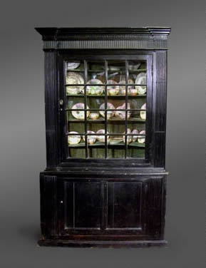 Two section corner cupboard, the upper section with glazing bars and elaborate cornice