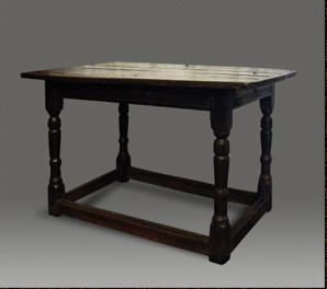 Antique Welsh low oak centre table, with moulded frieze and raised on turned legs, united by stretchers,