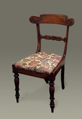 Set of four faux-rosewood dining chairs, with carved crest and cross rails