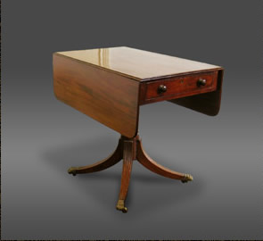 Mahogany drop leaf table known as a Pembroke table, on four splay legs ending in castors, circa 1800