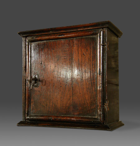 Antique Welsh oak wall-hanging spice cupboard of small proportions the  boarded door with moulded edging enclosing a fitted interior with two  drawers and a ... - Antique Welsh Oak Wall-hanging Spice Cupboard Of Small Proportions