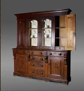 Welsh pine dresser with original painted finish and embellishments. The rack consisting of two elongated cupboards either side of a central glazed section, and the base consisting of six drawers and two cupboards.