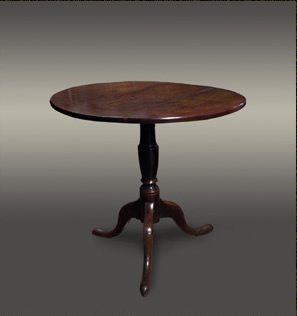 Welsh oak occasional table on a turned pedestal base with three shaped legs
