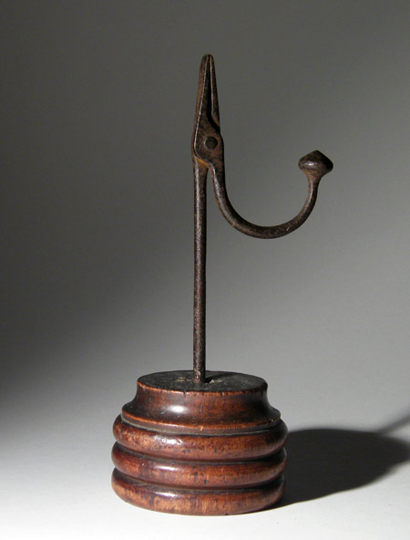 Antique 18th century Welsh wrought iron rushlight on an unusual ring turned fruitwood base