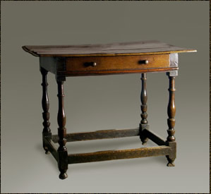 Antique Welsh oak side table, with a moulded - edged top over a single drawer and raised on finely turned legs and united by stretchers
