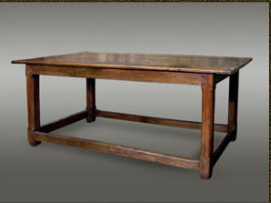 Welsh oak table, with a three-plank top with cleated ends, raised on square chamfered legs united by stretchers